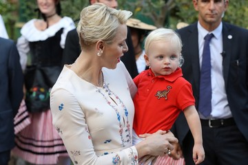 Princess Charlene of Monaco holds Prince Jacques, the heir apparent to the Monegasque throne during the traditional Monaco's picnic in Monaco.