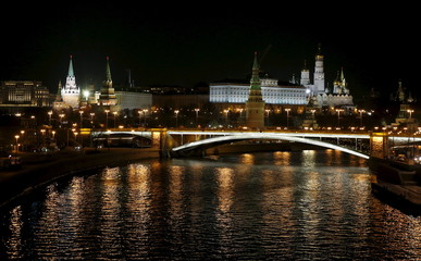 A view shows the Bolshoi Kamenny Bridge with the Kremlin in the background before their lights were switched off during Earth Hour in central Moscow