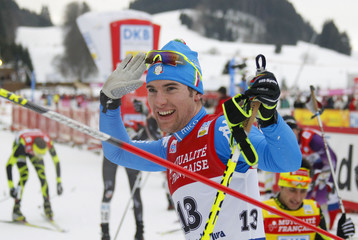 Pittin of Italy celebrates as he wins the 10 km individual event of the Nordic Combined World Cup in Chaux-Neuve