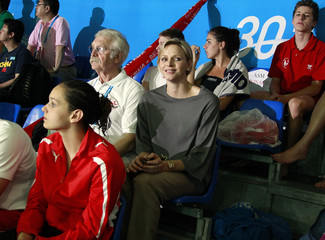 Monaco's Princess Charlene sits with Monaco's swimmers at the Mare Nostrum swimming meet in Monaco