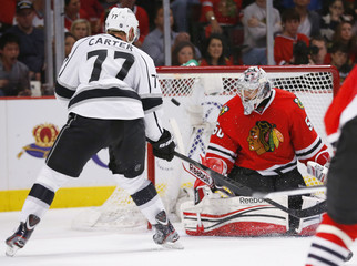 Blackhawks goalie Crawford blocks a shot from Kings' Carter in the third period of Game 1 of their NHL Western Conference final hockey playoff game in Chicago