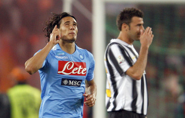 Napoli's Cavani celebrates after scoring against Juventus during their Italian Cup final at the Olympic stadium in Rome