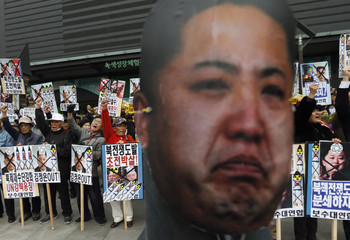 Anti-North Korean protesters chant slogans near an effigy of North Korean leader Kim during a protest in central Seoul