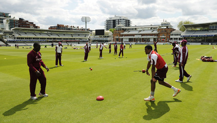 The West Indies team warms up during a training session before their first test cricket match against England in London
