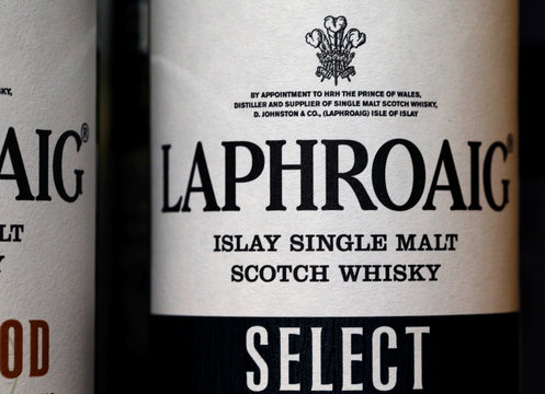 A logo is pictured on a bottle of single malt scotch whisky Laphroaig in a shop near Lausanne