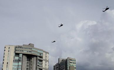 U.S military helicopters patrol over San Jose before U.S. President Barack Obama's arrival