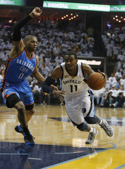 Oklahoma City Thunder guard Russell Westbrook defends Memphis Grizzlies guard Mike Conley during the first half of NBA basketball action in Memphis