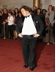 Actor Black poses for photographers on the red carpet as he arrives at the Kennedy Center in Washington