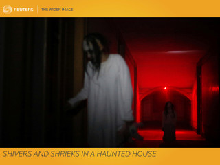 The Wider Image: Shivers and shrieks in a haunted house