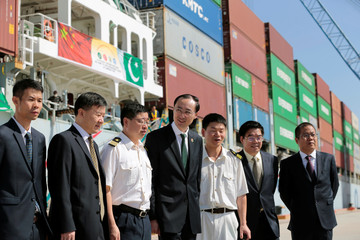 Sun poses for pictures with members of his staff and crew of the first container ship to depart after the inauguration of the China Pakistan Economic Corridor port in Gwadar