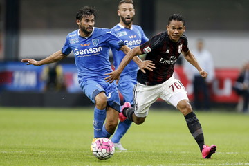 AC Milan's Bacca and Empoli's Zambelli fight for the ball during their Serie A soccer match in Milan