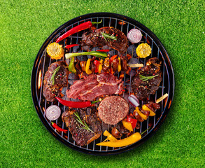 Acrylic Prints Grill / Barbecue Top view of fresh meat and vegetable on grill placed on grass