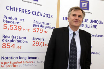Remy Weber, Chairman of La Banque Postale's executive board, poses prior to a news conference to announce the company's 2013 annual results in Paris