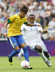 Honduras' Velasquez challenges Brazil's Neymar in their men's quarter final soccer match at the London 2012 Olympic Games at St James' Park in Glascow