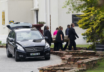 Body of model Reeva Steenkamp arrives at the Victoria Park Crematorium ahead of her memorial service in Port Elizabeth