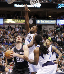 San Antonio Spurs' Splitter looks for a shot defended by Dallas Mavericks players during their NBA basketball game in Dallas