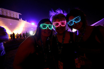 Concertgoers Amaradio, Walsh and Kelley pose for a photo at Desert Trip music festival at Empire Polo Club in Indio