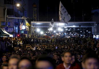 Supporters of Taiwan's Democratic Progressive Party Chairperson and presidential candidate Tsai Ing-wen wait for her to speak to the crowd following her victory in the presidential election in Taipei, Taiwan