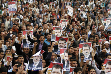 Supporters of deposed Egyptian President Mohamed Mursi shout slogans during a march to show solidarity with his supporters in Egypt, in Sanaa