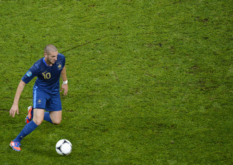 France's Benzema controls ball during their Group D Euro 2012 soccer match against Ukraine at Donbass Arena in Donetsk