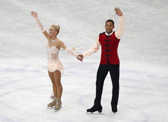 Germany's Savchenko and Szolkowy wave to fans after the pairs free skating program at the ISU World Figure Skating Championships in Saitama