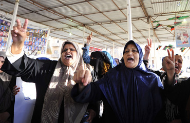 Women attend a demonstration near the court building in show of anger towards a car bomb attack in front of Galaa Hospital, in Benghazi