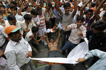Supporters of BJP attend a protest against the government for rise in fuel prices in New Delhi