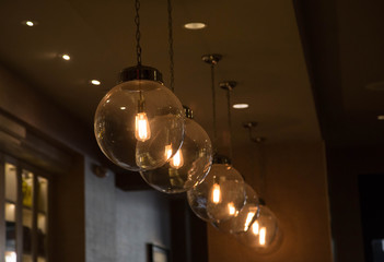 Round Light Fixtures In A Diagonal Row