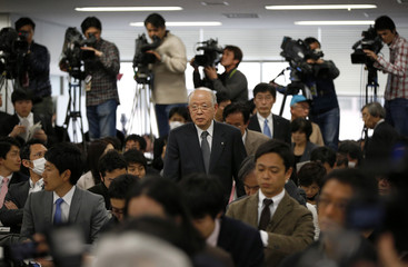 President of Japanese research institute Riken, Ryoji Noyori arrives at a news conference in Tokyo