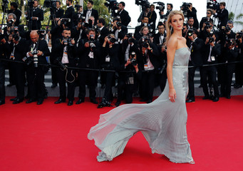 """Model Rosie Huntington-Whiteley poses on the red carpet as she arrives for the screening of the film """"The Search"""" in competition at the 67th Cannes Film Festival in Cannes"""
