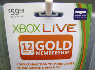 Xbox live gold membership cards are shown for sale at a Microsoft retail store in San Diego