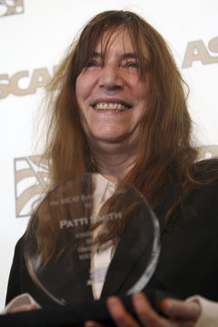 Rock icon Patti Smith holds her Founders Award at the 27th annual ASCAP Pop Music Awards in Hollywood