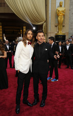 Jared Leto  and his brother Shannon Leto arrive on the red carpet at the 86th Academy Awards in Hollywood