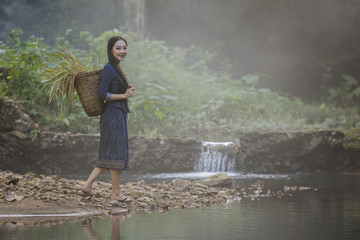 Portrait of beautiful rural woman wear Thai dress,countryside Thailand