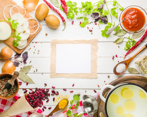Preparation of soup at home. Rustic white background with vegetables and ingredients around the perimeter.