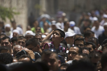 A boy looks up after prayers in Jerusalem's Old City on second Friday of Ramadan