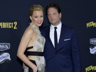 """Director/producer and cast member Elizabeth Banks (L) and husband Max Handelman and pose at the premiere of """"Pitch Perfect 2"""" in Los Angeles"""