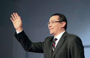 Romania's Prime Minister Ponta waves during an electoral rally in Craiova