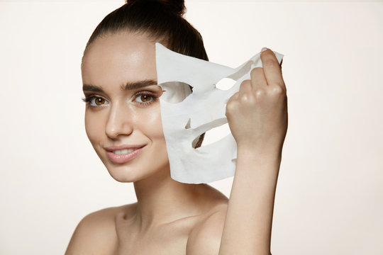 Woman Beauty Face. Young Female Removing Mask From Facial Skin