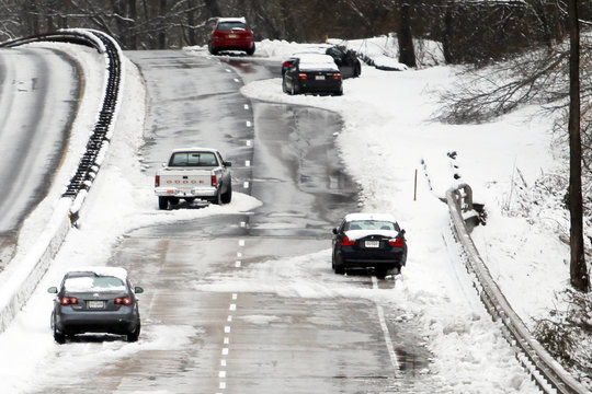 Abandoned vehicles litter the George Washington Parkway in McLean, Virginia, just outside Washington
