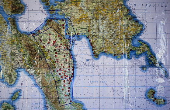 A map at the joint U.S. and Philippine Army headquarters in Tacloban airport shows the marked places where people need aid in the Central Philippines in the aftermath of Super Typhoon Haiyan