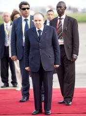 Algeria's President Abdelaziz Bouteflika arrives at the airport in Entebbe