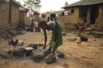 A woman cooks in Meliandou