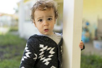 Toddler with a sad face.