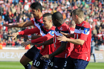 Lille's Eden Hazard celebrates with team-mates after he scored a penalty during their French Ligue 1 soccer match against Toulouse at Lille Metropole Stadium in Villeneuve d'Ascq