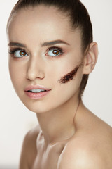 Beauty Cosmetics. Young Woman With Stripe Of Coffee Mask On Skin