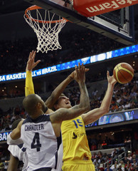Tyson Chandler of Team USA tries to stop Tiago Splitter of Brazil from going past during their Olympic men's exhibition basketball game in Washington