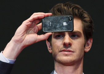 "Cast member Andrew Garfield takes a picture at the world premiere of ""The Amazing Spider-Man"" in Tokyo"