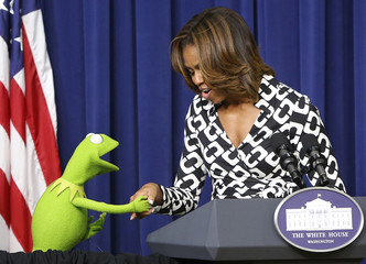 """Obama greets Kermit the Frog as they introduce a showing of the new movie """"Muppets Most Wanted"""" at the White House in Washington"""