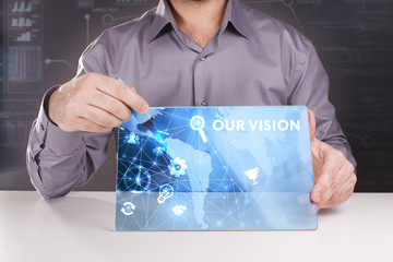 Business, Technology, Internet and network concept. Young businessman working on a virtual screen of the future and sees the inscription: Our vision